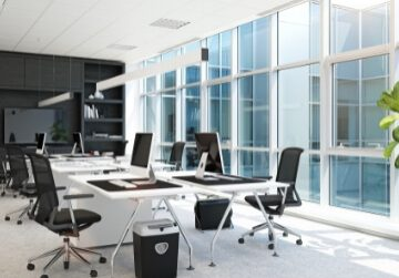 Conference room of an office with a large wall of windows